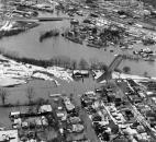 A view of downtown, with a flooded Sherman Boulevard and Sherman Bridge in the foreground.