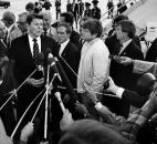"Fort Wayne Mayor Win Moses Jr., in the light-colored jacket in the center, repeatedly appeared on television to tell of the urgent need for volunteers. Later in the week, President Reagan, shown here surrounded by Secret Service agents, told a crowd at Baer Field ""how much their neighbors in the country feel for them and how concerned we are."""