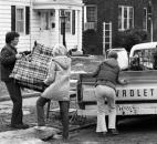 Dick Limburg and Sally Pallsen help move Kari Towns of 1505 E. Columbia Ave. after the area was ordered evacuated March 17.