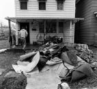 Ruined floor covering is piled outside the home of Cheryl Fryback, 1223 Elm St., after friends and relatives pitched in to help clean her kitchen on Sunday afternoon.