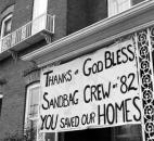 A resident displays a sign of gratitude for the sandbaggers' efforts.
