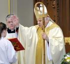 Bishop John D'Arcy, right, reads a blessing during Easter Mass in April 2009 at the Cathedral of the Immaculate Conception. News-Sentinel file photo
