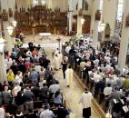 Bishop John D'Arcy, lower right, enters the Cathedral of the Immaculate Conception during the processional for Easter Mass in 2009. News-Sentinel file photo