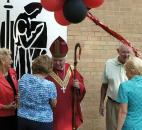From left, Judy Hershberger and Sandy Matthys chat with Bishop John D'Arcy in August 2008 after Bishop Luers High School celebrated its 50th anniversary with a Mass and rededication of the school. On the right are classmates from 1962, Steve McArdle and Mary Jane Millikan. They  were all in the first graduating class from Bishop Luers High School. Photo by Ellie Bogue