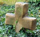 Remnants of the the former , like this stone cross, are visible in the gardens around the  church. Photo by Ellie Bogue
