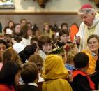 Bishop John D'Arcy, right, talks with fourth-grade students during an All Saints Mass in 2005 at the Cathedral of the Immaculate Conception. The students were dressed as their favorite saints. News-Sentinel file photo