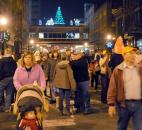 After the Santa and reindeer display was lit the crowd moved down the street for the lighting of the Wells Fargo holiday display and Indiana Michigan Power Merry Christmas wreath at Wayne and Calhoun streets. Photo by Ellie Bogue