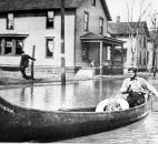 Many residents were evacuated by canoe or boat. (Photo courtesy of The History Center)