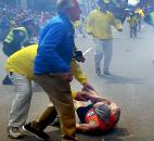 People react to a second explosion at the 2013 Boston Marathon in Boston. Photo by By The Associated Press