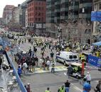 People react to an explosion at the 2013 Boston Marathon in Boston. Photo by By The Associated Press