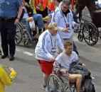 Workers aid injured people at the finish line of the 2013 Boston Marathon after an explosion in Boston. Photo by By The Associated Press