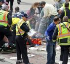 Rescue personnel aid injured people near the finish line of the 2013 Boston Marathon after explosions in Boston. Photo by By The Associated Press