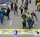Medical workers wheel the injured across the finish line during the 2013 Boston Marathon after an explosion in Boston. Photo by By The Associated Press