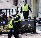 Boston police clear an area after an explosion near the finish line of the 2013 Boston Marathon in Boston. Photo by By The Associated Press