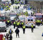 Police clear the area at the finish line of the 2013 Boston Marathon as medical workers help injured after explosions Monday in Boston. Photo by By The Associated Press