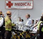 Medical personnel work outside the medical tent in the aftermath of two blasts near the finish line of the Boston Marathon in Boston. Photo by By The Associated Press