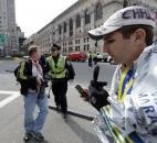 Boston police ask people to leave the area in Copley Plaza in the aftermath of two blasts near the finish line of the Boston Marathon in Boston. Photo by By The Associated Press