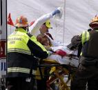 An injured person is loaded into an ambulance in the aftermath of two blasts near the finish line of the Boston Marathon on Monday in Boston. Photo by By The Associated Press