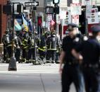 Firefighters gather one block from Boylston Street after an explosion at the finish line of the Boston Marathon in Boston. Photo by By The Associated Press