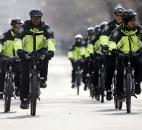 Boston police on bicycles patrol on Commonwealth Avenue after the explosions at the finish line of the Boston Marathon in Boston. Photo by By The Associated Press