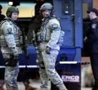 SWAT team members stand guard on the campus of Massachusetts General Hospital  after an explosion at the finish line of the Boston Marathon in Boston. Photo by By The Associated Press