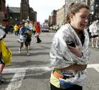 An unidentified Boston Marathon runner leaves the course crying near Copley Square after an explosion in Boston. Photo by By The Associated Press