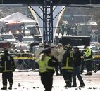 Emergency responders gather around the finish line of the Boston Marathon after an explosion in Boston Monday. Photo by By The Associated Press