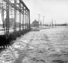 Looking west from the bridge, Taylor Street disappeared under water from the St. Marys River. (Photo courtesy of The History Center)
