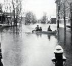 An unidentified canoeist paddled up Marion Street, east of the old Bloomingdale School. (Photo courtesy of The History Center)