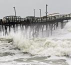 Waves from Hurricane Sandy crash onto the damaged Avalon Pier in Kill Devil Hills, N.C., on Monday as Sandy churns up the East Coast.