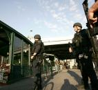 Port Authority Police from the Emergency Service Unit patrol the area at the Hoboken Terminal in New Jersey.  Extra security was taken during the evening rush Monday after the explosions at the Boston Marathon. Photo by By The Associated Press