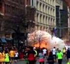 In this image from video provided by WBZ TV, spectators and runners run from what was described as twin explosions that shook the finish line of the Boston Marathon on Monday. Two explosions shattered the euphoria of the Boston Marathon finish line, sending authorities onto the course to carry off the injured while the stragglers were rerouted away from the smoking site of the blasts. Photo by By The Associated Press