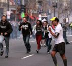 In this photo provided by The (Boston University) Daily Free Press and Kenshin Okubo, people react to an explosion at the 2013 Boston Marathon in Boston on Monday. Photo by By The Associated Press