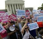 Supporters of President Obama's health care overhaul celebrate outside the Supreme Court in Washington after the court ruled in June to uphold the sweeping law. Photo by The Associated Press