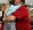A teacher hugs a child at Briarwood Elementary school after a tornado destroyed the school Monday in south Oklahoma City. (Photo by The Associated Press)