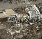 This aerial photo shows the remains of homes hit by a massive tornado Monday in Moore, Okla. (Photo by The Associated Press)