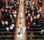 Bishop John D'Arcy, bottom center, walks down the main aisle of the Cathedral of Immaculate Conception to begin Mass for Mother Teresa in September 1997. About 300 people gathered for the service. News-Sentinel file photo