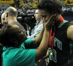 Dawn Clopton dries her daughter Brittni's tears after South Side lost to Bedford North Lawrence 54-51 Saturday night in the IHSAA Class 4A state title game in Terre Haute. (Photo by Ellie Bogue)