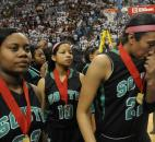 The Archers make their way off the floor after receiving runner-up medals for the IHSAA Class 4A state title game Saturday in Terre Haute. South Side lost 54-51 to Bedford North Lawrence. From left are De'Joyah Johnson, Nahja King and Ariana Simmons. (Photo by Ellie Bogue)