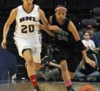South Side's Ariana Simmons is pressed by Dominique McBryde of Bedford North Lawrence in the first quarter. (Photo by Ellie Bogue)