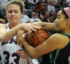 Bedford North Lawrence's Jenna Allen tangles for the ball with South Side's Lakesha LaMaster-Stephens in the second quarter. (Photo by Ellie Bogue)