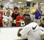 Team USA World Cup player and Fort Wayne native DaMarcus Beasley, lower right, signs autographs on soccer balls, shoes, shirts and anything else the participants in his Beasley National Soccer Camps have with them on Tuesday at The Plex. Beasley returned to the U.S. two weeks ago after Team USA was knocked out of the World Cup tournament and is visiting several of the soccer camps under his namesake that are in session nationwide.