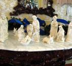 A nativity set graces a table in the sunny drawing room.