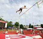 Jared Schipper of Bishop Dwenger easily clears the bar on his first attempt in the pole vault event. Schipper won the event with a vault of 16-3. (Photo by Gannon Burgett for The News-Sentinel)