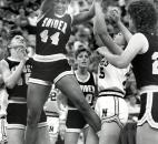 Yolanda Naylor grabs a rebound during Snider's 60-58 victory against Noblesville in the 1988 state finals at then-Market Square Arena in Indianapolis. Snider finished the season 27-1 and prevented Noblesville from repeating as state champions. News-Sentinel file photo