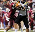Snider's Addison Dellinger pulls in a reception under pressure from a Lawrence Central defender. Photo by Rob Edwards