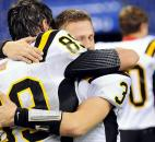 "Snider's Addison Dellinger, left, and Brandon Phelps hug after their 39-""4 loss to Lawrence Central in the Class 5A state title game. Photo by Rob Edwards"