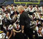 "Snider coach Kurt Tippman talks to his team after the Panthers were defeated 39-""4 by Lawrence Central in Saturday's Class 5A state title game at Lucas Oil Stadium in Indianapolis. Photo by Rob Edwards"