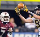 Snider's Joshua Spitnale makes a catch in front of Lawrence Central's Quenten Turman. Photo by Rob Edwards