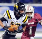 Snider's Andreas Gomez-Espino makes a catch in front of Lawrence Central's Delon Pettiford. Photo by Rob Edwards